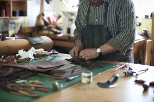 florentine leather: Male worker in leather workshop