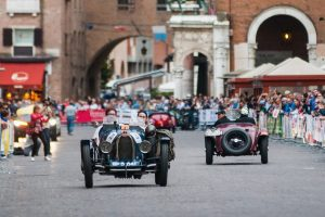 Mille Miglia: a Bugatti passes through the city centre of Ferrara